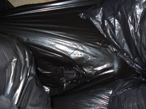 An air hole visible in a bagging / dumpster scene from 2010