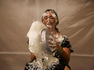 Mistress Messiér demonstrates the art of the pie sandwich on Maya Kralovna at the Debauchery 2012 messyplay demo.